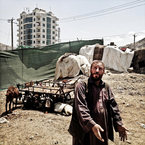 <p>A returning refugee, who came back to Afghanistan after years of exile in Pakistan and now lives in a shantytown surrounded by new high-rise construction sites, gestures to the luxury apartments around him and says: &quot;They have that; we have this.&quot;</p>