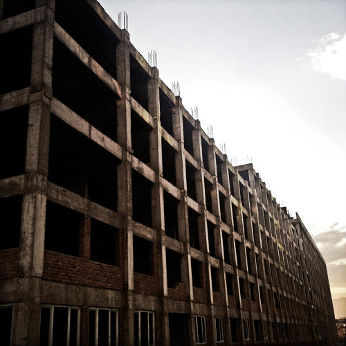 <p>An apartment complex in Kabul, stalled midway through constructed as the real estate market declined.</p>