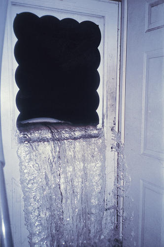 "<p>Among his favorites along those lines is a photo taken by a man named Michael Stewart, who is standing in his doorway as the floodwaters are about to break through a storm door. ""It's a photograph that is so stark and so jarring, but it's a photograph that you would never have seen in the news media.&quot;</p>"