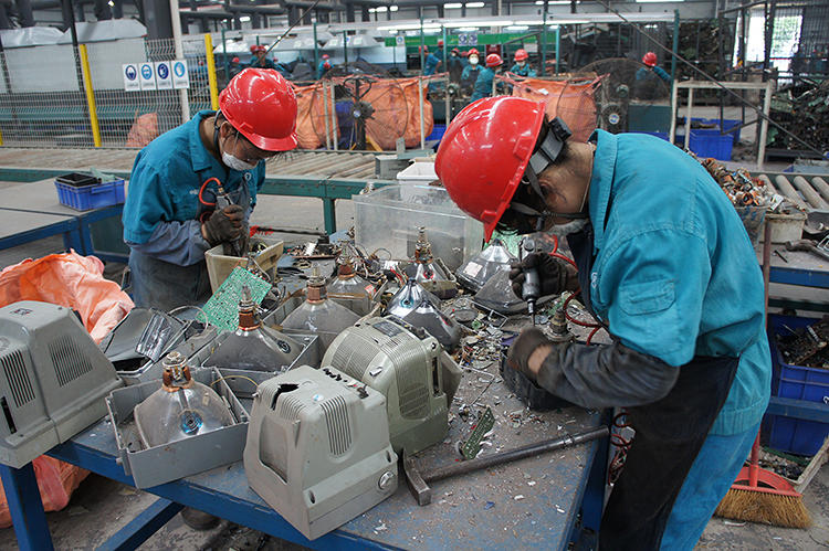<p><a href=&quot;http://shanghaiscrap.com/2013/09/scenes-from-a-junkyard-planet-its-never-easy/&quot; target=&quot;_blank&quot;>Workers in Sichuan Province</a> dismantling small television monitors inside of one of China's newest facilities.</p>