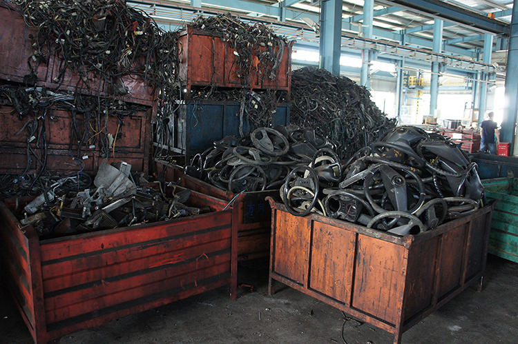 <p>A Shanghai-area automobile recycling facility, <a href=&quot;http://shanghaiscrap.com/2013/10/scenes-from-a-junkyard-planet-this-wheels-not-on-fire/&quot; target=&quot;_blank&quot;>in July 2013</a>, where every last part, even steering wheels, are recovered from junk cars.</p>