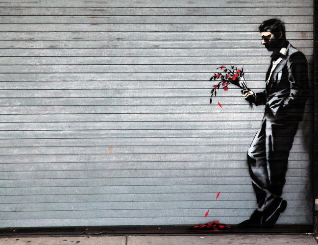 <p>The artist managed to stencil this on the shutter of the Hustler Club in Hell's Kitchen without attracting unwanted attention--just like the subject of the painting.</p>  <p>[<em>Image: <a href=&quot;http://www.banksy.co.uk&quot; target=&quot;_blank&quot;>Banksy</em></a>]</p>