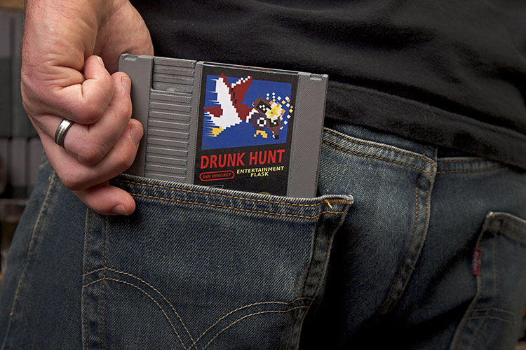 <p>Easily slipped in your back pocket, this slim flask is very discreet. No one will suspect you're drinking whiskey – they'll just think you're sucking on an old Nintendo game.</p>