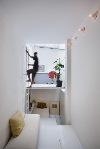 "<p>All of the stairs and levels make the apartment feel a lot more spacious than it actually is, the architects say. ""The space is bigger because you need to go up and down to change ""rooms.'&quot;</p>"