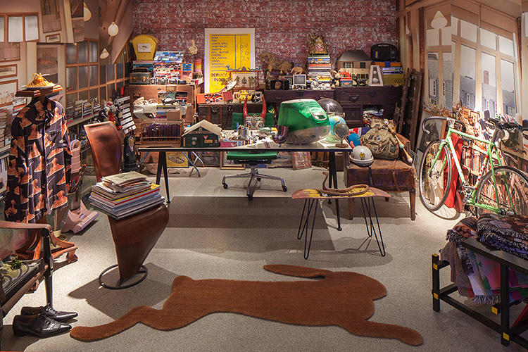 <p>The exhibition's recreation of Smith's office reveals his child-like love of toys and trinkets. There's also one of the first, hefty iMacs, in candy-apple green--a gift from Smith's friend, Apple designer Jonathan Ive.</p>