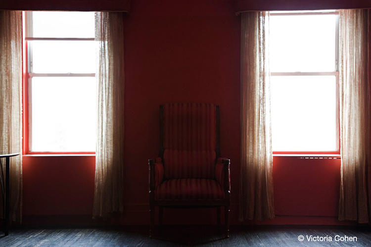 """Number 1024 had a very powerful aura as I walked in,"" Cohen writes. ""The whole room was blood red, the walls, the furnishings. The feeling was intense."""