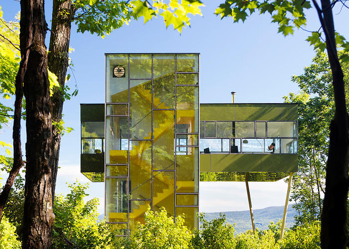 <p>This three-bedroom &quot;<a href=&quot;http://www.fastcodesign.com/1672613/a-skyscraper-style-treehouse-with-soaring-mountain-views&quot; target=&quot;_self&quot;>adult tree house</a>&quot; from GLUCK+ takes the form of a tiny skyscraper, offering plush views into the Catskills and beyond. A glass stairwell acts like a &quot;solar chimney&quot; to funnel out hot air in the summer, reducing energy costs.</p>