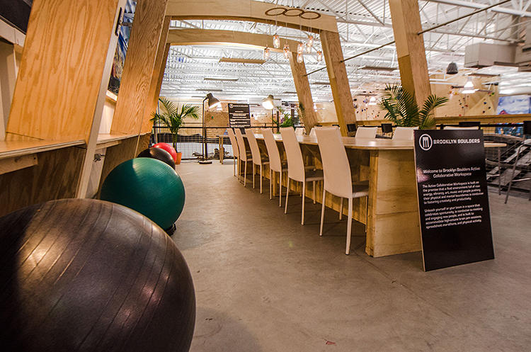 <p>The workspace, planted in the middle of a 40,000-square-foot climbing facility, is located on top of a 120-foot long and 22-foot high climbing wall.</p>