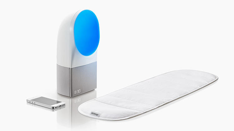 <p>Aura is an alarm clock that uses light to hack your circadian rhythm. (And that big pad measures your sleep patterns in the process.)</p>