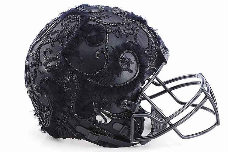 <p>Marchesa. All proceeds from the auction will go to the <a href=&quot;http://www.nflfoundation.org/&quot; target=&quot;_blank&quot;>NFL Foundation</a>, a nonprofit dedicated to improving the health and safety of athletes and football communities.</p>