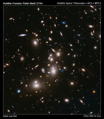<p>This composite image taken by the Hubble Space Telescope takes advantage of gravitational lensing to use the immense gravity of the foreground galaxy cluster Abell 2744, commonly known as Pandora's Cluster, to capture the deepest ever view of a galaxy cluster. It shows almost 3,000 background galaxies as they would have appeared 12 billion years ago, not long after the Big Bang. The image shows some of the faintest and youngest galaxies ever detected in space. Without gravitational lensing, most of these background galaxies would be invisible.</p>