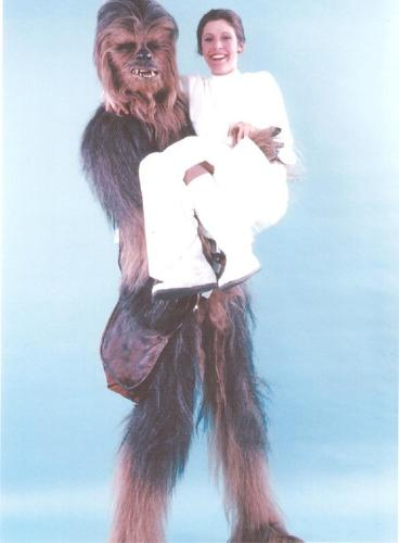 <p>Actor Peter Mayhew as Chewbacca picks up a young Carrie Fisher.</p>
