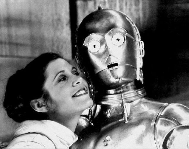 <p>Even C-3P0 was not immune to Carrie Fisher's charms.</p>