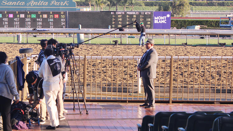 <p>Filming expert commentary before the races start.</p>