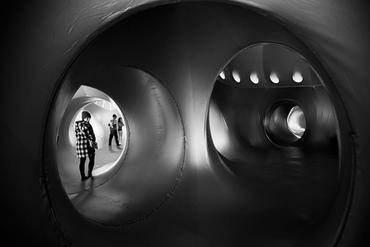 <p>The cavernous labyrinth of pathways connecting the various rooms inside the luminarium.</p>
