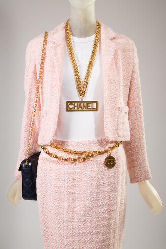 "<p>Self-branding: Madonna's hit single ""Material Girl"" summed up fashion trends of the 1980s. If you had money, you flaunted it, as seen in this Chanel (Karl Lagerfeld) suit from 1994 and necklace from fall 1991.</p>"