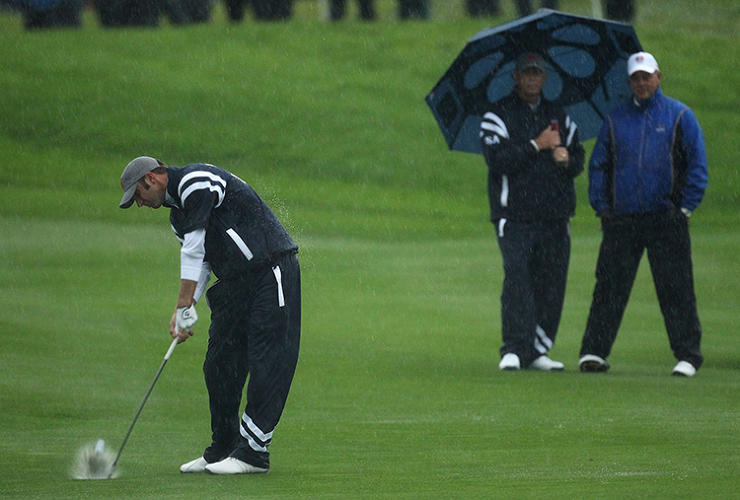 <p>After shivering under umbrellas, Tiger Woods and the rest of the American team had to hit up the merchandise tent and spend $6,552 on new raincoats, which were emblazoned with the Euro team's Ryder Cup logo. Eep.</p>