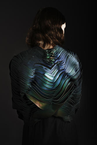 <p>Bowker and her London studio, The Unseen, then designed a huge tiered leather jacket that engulfed the wearer like a mascot costume. Then, they lit it on fire.</p>