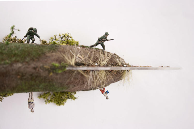<p>He uses and modifies existing miniatures, like army men.</p>