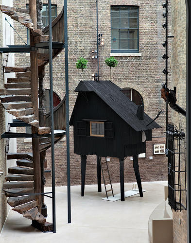 <p>The miniscule Beetle's House--just 13 square feet--was inspired by traditional Japanese teahouses. The Tim Burton-esque dwelling stands on spindly legs and sprouts two antennae-like trees from its roof. Inspired by black tea, it's finished both inside and out with black charcoal.</p>