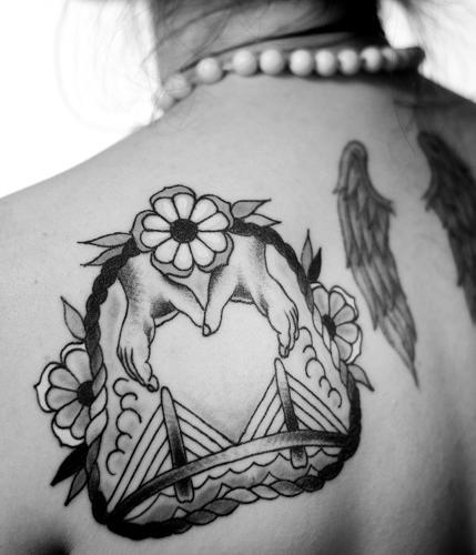 <p>Sarah-Jean &quot;SJ&quot; Greaves tattoo is based off a piece of artwork by Boston-based singer-songwriter Dan Blakeslee, who is her friend.</p>