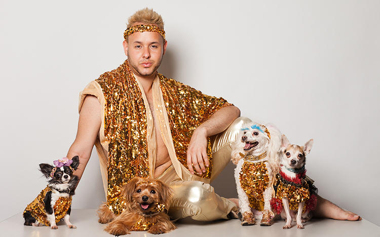 "<p>""Pretty much all of the human characters who attend these events are some of the most passionate, fun-loving, larger than life people I have ever met,"" Nathan says. Here, dog couturier Roberto Negrin with Athena, Abby, Hec-lin, and DJ.</p>"