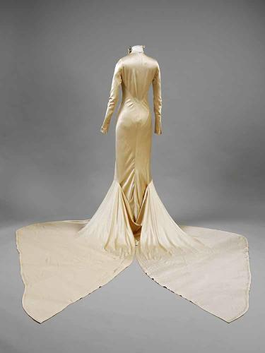 <p>The slinky, slim-hipped designs of the '20s and '30s drew inspiration from evening fashions and Hollywood glamor. Baba Beaton, sister of legendary photographer Cecil Beaton, wore this silk satin dress in 1934.</p>