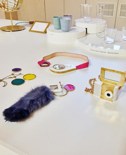 <p>The Holdables series of fashionable wearables uses OLED technology to perform silly tasks--like kissing the camera to trigger the flash and lens. Seen at the Austrian Confession of Design exhibit.</p>