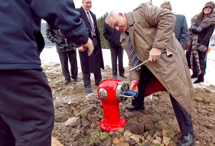 <p>Sigelakis testing out the first SPARTAN hydrant, installed in 2010 in Franklin, Pennsylvania.</p>