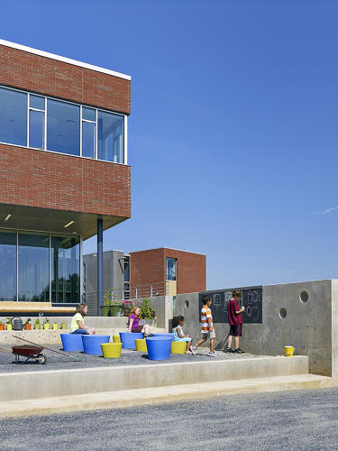 <p>Outdoor terraces at Buckingham County Primary and Elementary School facilitate creative play and group learning, while connecting students to the natural environment around them.</p>