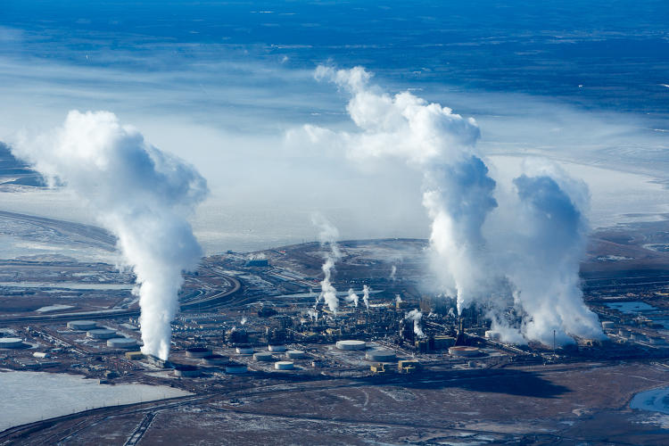 <p>Rising steam and smoke at the Syncrude Mildred Lake upgrade refinery.</p>