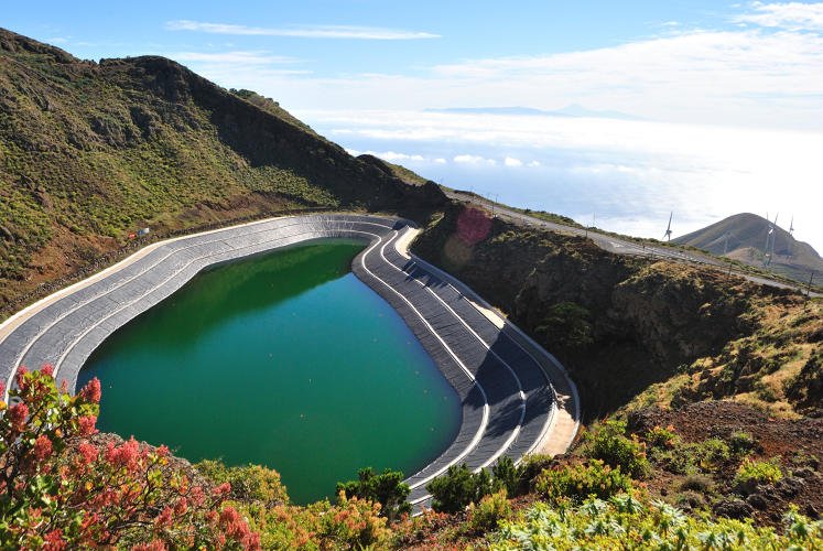 <p>At El Hierro, a volcanic crater doubles as a water reservoir. Hydroelectric power generated from it will fuel the island's homes and desalination plants.</p>