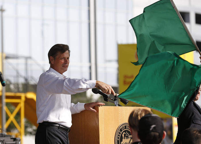 <p>Niel Golightly, vice president, communications, Shell Oil Company, waves the flag during opening ceremonies of Shell Eco-marathon Americas 2014, Friday, April 25, 2014, at the George R. Brown Convention Center in Houston.</p>