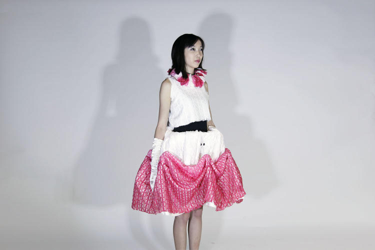 <p>Proximity sensors identify when someone gets too close, and plastic scaffolding within the garment causes the hemline to expand outward.</p>