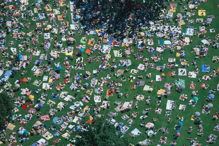 <p>Maclean took this image of picnickers in Massachusetts while flying a plane across the country.</p>