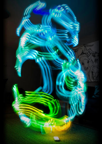 <p>Luis Hernan's self-portraits show the artist and Newcastle University researcher dancing in a cloud of colorful Wi-Fi signals.</p>