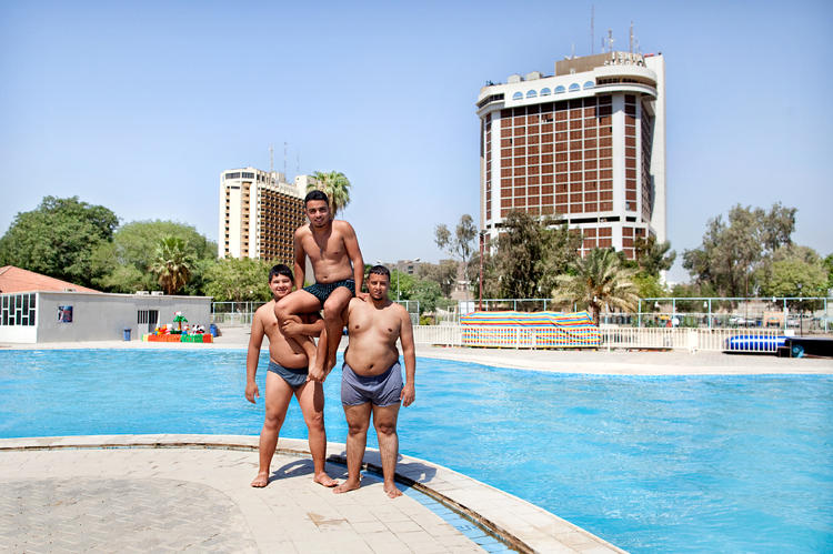 <p>Boys horsing around at a pool near the Tigris River. &quot;Those guys were just there. The translator was busy so we couldn't talk to one another, but without words they just did this for me. They gave us free smoothies--the best I've ever had,&quot; van der Velden says.</p>