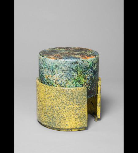 <p>The cylindrical table, like the rod-shaped bench, has simple shapes to go along with its bold paint.</p>