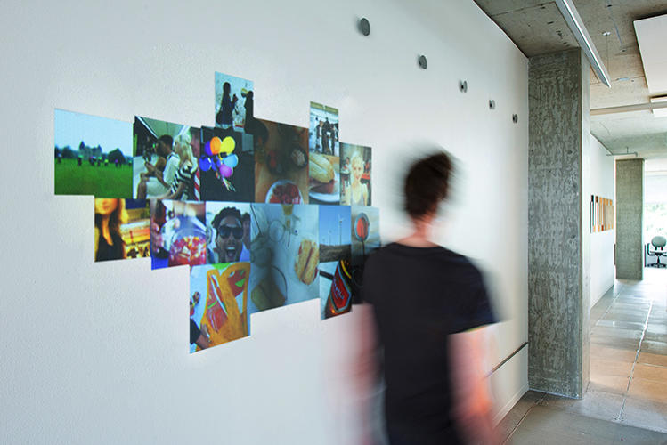 <p>You preload images you want to associate with yourself online, and then, as you walk by this installation, the wall identifies you and posts your images.</p>