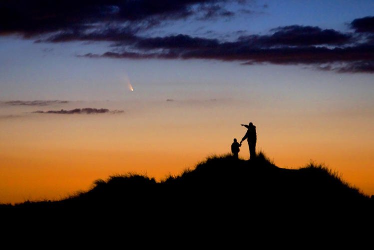 <p>A father and his young son watch the evening display of Comet PanSTARRS on First Encounter Beach, Eastham, Massachusetts, USA. The photographer had spent weeks preparing the shoot to capture the comet, which will not be seen again for over 100,000 years, in order to foster his son's interest in astronomy.</p>