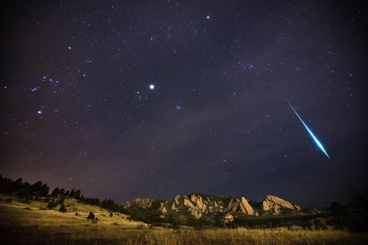 <p>The Geminid meteor shower races over the Flatirons of Boulder, Colorado, in December 2012. A fragment burns bright enough to outshine all of the planets, producing what's called a Fireball. Orion can also be seen in the photograph trailing across the sky toward the Pleiades and the glow of Jupiter inside the constellation of Taurus.</p>