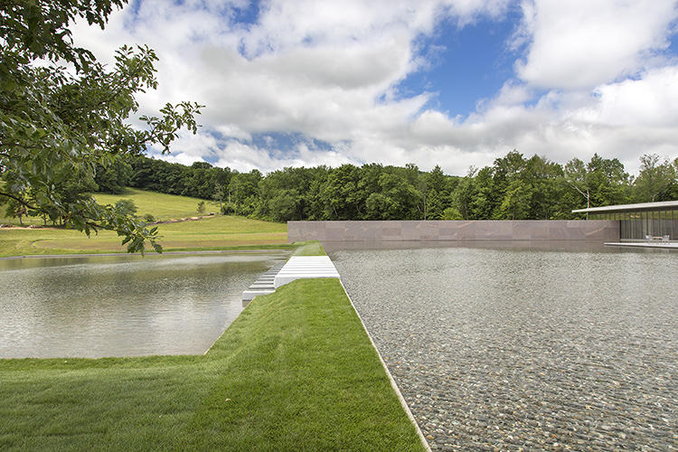 <p>The Clark renovation project has taken over a decade, but Ando's vision of creating a landscape with a large water feature that connects the two original buildings of the museum with the new Clark Center, remains intact.</p>