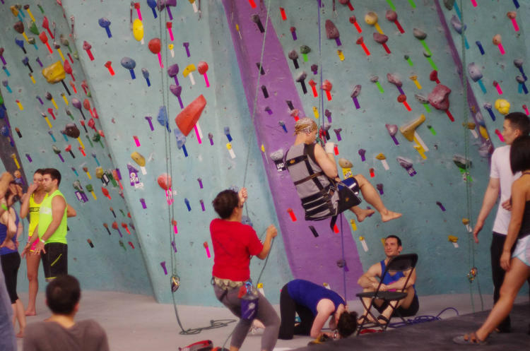 <p>Volunteers with the Adaptive Climbing Group lower a paraplegic climber at Brooklyn Boulders</p>