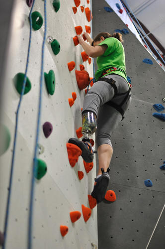 <p>Emily Harvey climbs a rock wall at Earth Treks climbing gym in Golden, Colorado.</p>