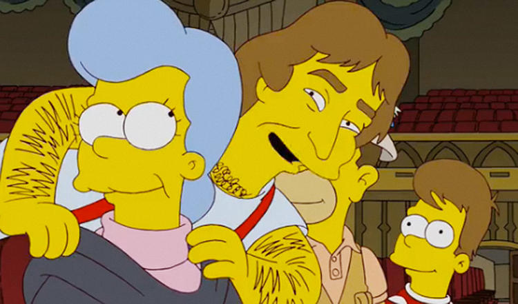 <p>In the unfortunately titled <em>Simpsons</em> episode, &quot;How I Wet Your Mother,&quot; Homer dreams of Robin Williams. The suspenders-wearing edition. Elsewhere, in the episode &quot;Grift of the Magi,&quot; a joke is made of Williams's legendary hairiness. (See next slide.)</p>