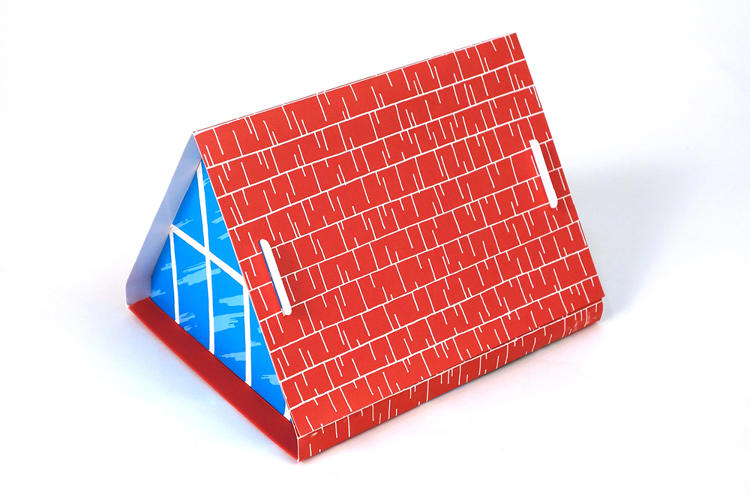 <p>The package of the postcards itself, illustrated with red wood planks and windows, folds out to become its own little A-frame dwelling, big enough for, say, your pens on your desk to take a vacation inside.</p>