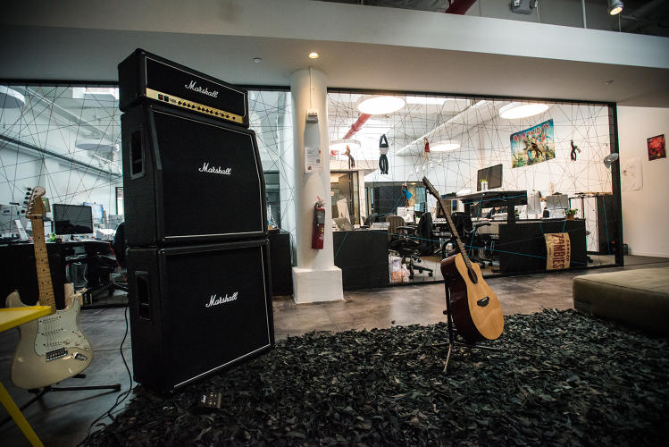 <p>Naturally, there's a Marshall stack and several guitars sitting in the middle of the office floor.</p>