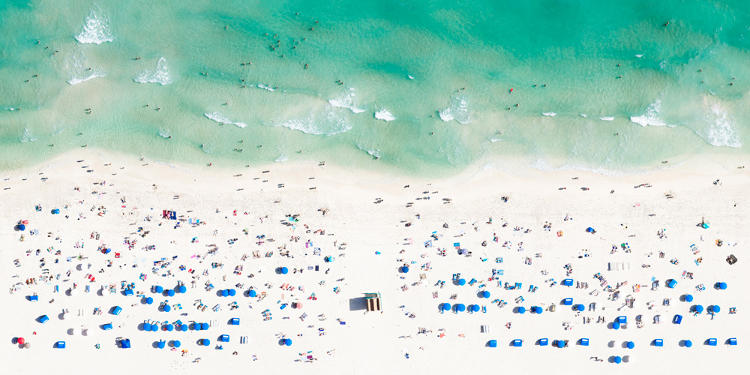 <p>But it was only after flying over the beaches of Ipanema and Copacabana during a kiteboarding final in Rio that Rose turned his lens from athletes to beachcombers, snapping the herd-like patterns of their oiled hides and colorful beach towels and umbrellas from the air.</p>