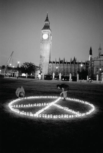 <p>Candles are aligned to form the CND symbol to mark the 50th anniversary of the atomic bomb being dropped on Hiroshima.</p>