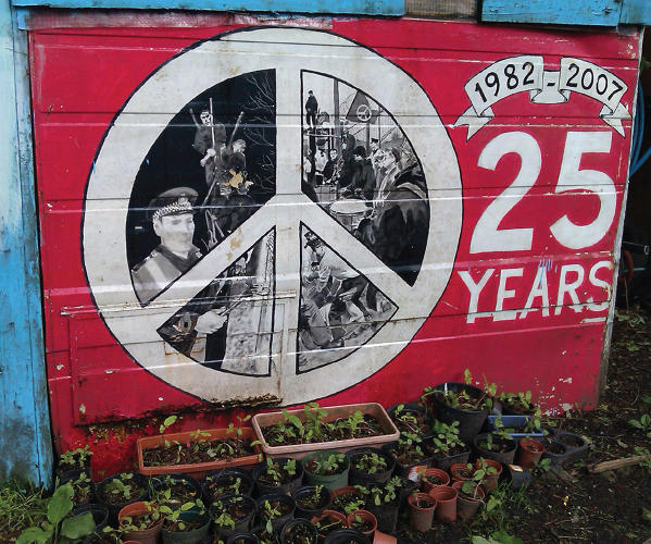 <p>A CND symbol mural at Faslane Peace Camp which was set up at the Faslane Naval base – the home of Britain's fleet of Trident nuclear-armed submarines.</p>